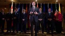 Federal Finance Minister Bill Morneau, centre, is flanked by his provincial and territorial counterparts as he speaks during a news conference after reaching a deal to expand the Canada Pension Plan, in Vancouver, B.C., on Monday June 20, 2016. (DARRYL DYCK/THE CANADIAN PRESS)