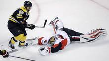 Ottawa Senators goalie Craig Anderson makes a diving save on a shot by Boston Bruins left winger Brad Marchand during Game 4 on Wednesday, April 19, 2017, in Boston. (Charles Krupa/AP)