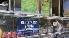 A voter registration sign is seen on a taco truck, as part of the U.S. Hispanic Chamber of Commerce's 'Guac the Vote' campaign, in Houston, Texas, on Sept. 29, 2016. (TRISH BADGER/REUTERS)