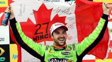 IndyCar driver James Hinchcliffe, of Canada, celebrates after winning the IndyCar's Sao Paulo 300 auto race in Sao Paulo, Brazil, Sunday, May 5, 2013. (Andre Penner/AP Photo)