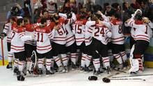 Team Canada celebrates after Sidney Crosby scored in overtime to give Canada the win over the U.S. in the gold-medal hockey game at the Vancouver Olympics. (Fred Lum/The Globe and Mail)