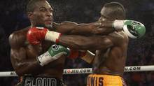 Adonis Stevenson, from Montreal, and Tavoris Cloud, from Florida, exchange blows during their Light heavyweight fight Saturday, September 28, 2013 in Montreal. (RYAN REMIORZ/THE CANADIAN PRESS)
