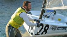Ben Ainslie of Britain arrives back with his boat at the Royal Perth Annexe after being involved in an incident on course during the Finn class gold fleet racing at the ISAF World Sailing Championships off Fremantle near Perth on December 10, 2011. British Olympic hero Ben Ainslie overcame controversy and an ugly confrontation with a media boat to retain a handy buffer heading into the December 11 medal race in the Finn class at the ISAF Sailing World Championships in Western Australia. (GREG WOOD/AFP/Getty Images)