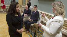 Governor-General David Johnston and Prime Minister Justin Trudeau look on as Jody Wilson-Raybould is sworn in as the Minister of Justice and Attoney-General of Canada during ceremonies at Rideau Hall, Wednesday Nov.4, 2015 in Ottawa. (Adrian Wyld/THE CANADIAN PRESS)