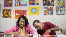Pela Vidda aims to foster community among HIV-positive and HIV-negative Brazilians with regular arts classes. Here, Maria da Conceição Rodrigues Ferreira (72, left) and Agenor Gonçalves dos Santos (77, right) put the finishing touches on their projects. (Jimmy chalk for The Globe and Mail)