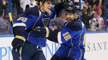 St. Louis Blues centre Derek Roy, right, congratulates left wing Alexander Steen after assisting on Steen's second goal in the first period during an NHL hockey game against the Montreal Canadiens, Thursday, Dec. 19, 2013, in St. Louis. (CHRIS LEE/AP)