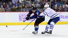 Colorado Avalanche center Matt Duchene (9) attempts a shot on the net as Toronto Maple Leafs defenseman Cody Franson (4) defends in the third period at Pepsi Center. The Avalanche defeated the Leafs in a shootout 4-3. (Ron Chenoy/USA Today Sports)