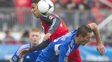 Toronto FC 's Luis Silva (left) battles for the ball with Montreal Impact's Davy Arnaud during first half MLS action in Toronto on Saturday October 20, 2012. (Chris Young/THE CANADIAN PRESS)