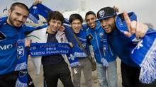 Montreal Impact soccer fans cheer on their team outside the Olympic Stadium in Montreal, Saturday, March 17, 2012, ahead of the Impact's first home MLS game against the Chicago Fire. THE CANADIAN PRESS/Graham Hughes (Graham Hughes)