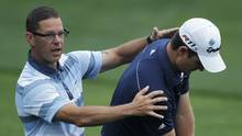 Swing coach Sean Foley, left, works with Olympic gold medalist Justin Rose, but through Golf & Body NYC, he also offers an intensive program for recreational players. (Chris O'Meara/The Associated Press)