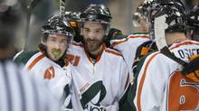 UQTR Patriotes centre Olivier Donovan, left, Emmanuel Boudreau and Christophe Tremblay-Losier celebrate a goal in third action in CIS University Cup hockey in Saskatoon on Friday, March 15, 2013. The Patriotes defeat the Huskies 3-1. (Liam Richards/THE CANADIAN PRESS)