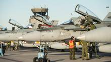 A CF-188 Hornet pilot prepares his aircraft to depart from Canadian Forces Base Bagotville on Oct. 23, 2014. (Leading Seaman Alex Roy/LS Alex Roy)