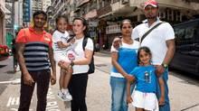 Refugees Ajith Pushpakumara (L to R), Vanessa Rodel and daughter Keana and her mother, Nadeeka Dilrukshi Nonis with Supun Thilina Kellapatha holding their daughter Sethumdi .They hid Edward Snowden in Hong Kong. (Jayne Russell)