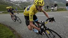 Race leader jersey holder Team Sky rider Christopher Froome of Britain cycles during the 204.5 km stage of the centenary Tour de France cycling race from Bourg d'Oisans to Le Grand Bornand, in the French Alps, July 19, 2013. REUTERS/Jacky Naegelen (JACKY NAEGELEN/REUTERS)