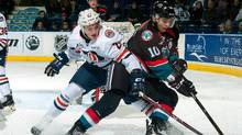 Nolan Kneen #27 of the Kamloops Blazers stick checks Nick Merkley #10 of the Kelowna Rockets as he skates with the puck during third period on November 1, 2016 at Prospera Place in Kelowna, British Columbia, Canada. (Marissa Baecker/Getty Images)
