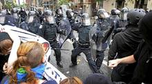 Anti-summit protesters clash with police in downtown Toronto, June 25, 2010. (Kevin Van Paassen/The Globe and Mail/Kevin Van Paassen/The Globe and Mail)