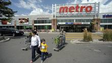 Shoppers leave a Toronto Metro store. (Fred Lum/Fred Lum/The Globe and Mail)