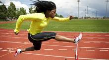 Hurdler Perdita Felicien, who now lives in Calgary, Alta., trains at the Glenmore Atheltic Park Monday, June 20, 2011. (Jeff McIntosh/Jeff McIntosh/The Globe and Mail)