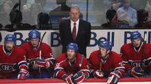 Montreal Canadiens head coach Michel Therrien watches from behind the bench during third period NHL hockey action against the Toronto Maple Leafs in Montreal, January 19, 2013. (CHRISTINNE MUSCHI/REUTERS)