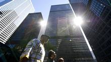 Banks tower above pedestrians in Toronto's financial district. (Kevin Van Paassen/The Globe and)