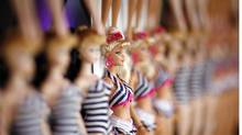 Barbie dolls are lined up on the wall at a 50th birthday party at Barbie's real-life Malibu Dream House in Malibu, California March 9, 2009. (MARIO ANZUONI/Mario Anzuoni/Reuters)