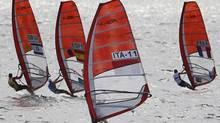 Competitors race in the RS:X Class event at the ISAF Sailing World Championships in Perth, Australia, Sunday, Dec 11. 2011. (AP Photo/Theron Kirkman) (Theron Kirkman/AP)