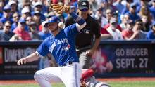 Toronto Blue Jays third baseman Josh Donaldson (20) bobbles the ball after tagging Boston Red Sox left fielder Brock Holt (12) who safely stole third base during a game on Sunday, September 11th. (Peter Power/THE CANADIAN PRESS)