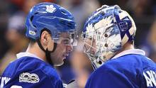 Toronto Maple Leafs centre Auston Matthews (34) and goalie Frederik Andersen (31) congratulate each other after their win over the New York Islanders following NHL hockey action in Toronto on Tuesday, Feb.14, 2017. (Frank Gunn/THE CANADIAN PRESS)
