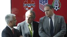 Sunil Gulati, left, President of the United States Soccer Federation, Decio de Maria, center, President of the Mexican Football Federation, and Victor Montagliani, President of the Canadian Soccer Association, hold a news conference, Monday, April 10, 2017, in New York. (Mark Lennihan/AP)
