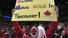A Canadian fan cheers as she waits for the start of the Women's Gold Medal Hockey game between USA and Canada at the Canada Hockey Place during the XXI Winter Olympic Games in Vancouver, Canada on February 25, 2010. (LUIS ACOSTA/Luis Acosta/AFP/Getty Images)