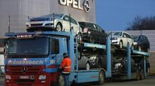 File photo of a worker entering a truck loaded with Opel cars at the Opel assembly plant in Bochum February 18, 2009. Opel, the ailing European brand belonging to General Motor, said it plans to end vehicle production in 2016 at its acutely endangered Bochum plant in Germany, the company said December 10, 2012. (INA FASSBENDER/REUTERS)