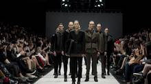 Models pose for the Rad Hourani show at Toronto Fashion Week on Friday March 16, 2012. (Chris Young/THE CANADIAN PRESS)