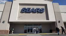 In this Feb. 22, 2012 photo, shoppers enter a Sears department store location in Dedham, Mass. (Steven Senne/AP)