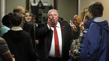 Toronto Mayor Rob Ford blows a kiss to the media while touring City Hall with a group of kids during the annual Take Your Kid to Work Day. (Fernando Morales/The Globe and Mail)
