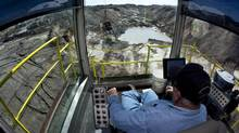 A dragline operator moves around phosphate rocks while mining at Mosaic's South Fort Meade Mine in Fort Meade, Fla. (SCOTT AUDETTE/REUTERS)