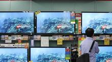 A man looks at Sony's TV sets which are displayed at an electronic shop in Tokyo June 22, 2012. (KIM KYUNG-HOON/REUTERS)