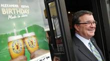 Finance Minister Jim Flaherty leaves an Ottawa news conference after announcing measures to support for small businesses on Oct. 4, 2011. (BLAIR GABLE/REUTERS)