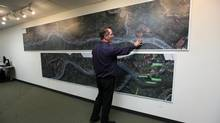 BC Hydro Manager, Community Relations Dave Conway, shows the various maps showing the flooding zones at the Community Consultation Office in Fort St. John on January 16, 2013 which is open for people to come in and asks questions about the proposed Site C Hydro Development Dam near Fort St. John on the Peace River. (Deborah Baic/The Globe and Mail)