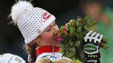 First placed Mikaela Shiffrin of the U.S. smells her bouquet of flowers on the podium during the flower ceremony of the women's Slalom race at the World Alpine Skiing Championships in Schladming February 16, 2013. (LEONHARD FOEGER/REUTERS)