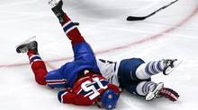 Montreal Canadiens right wing George Parros (15) hits his head on the ice as he fights with Toronto Maple Leafs right wing Colton Orr (28) during the third period at Bell Centre. (JEAN-YVES AHERN/REUTERS)