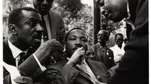 Martin Luther King (centre) in Birmingham, Ala., in a December, 1965, photograph by Bob Fitch. (RYERSON IMAGE CENTRE)