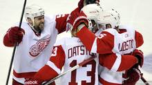 Detroit Red Wings left wing Tomas Holmstrom (L) celebrates his third period game winning goal against the San Jose Sharks with teammates Pavel Datsyuk (13) and defenseman Nicklas Lidstrom (5) during Game 5 of the NHL Western Conference semi-final hockey playoff in San Jose, California May 8, 2011. (CHAD ZIEMENDORF/REUTERS)