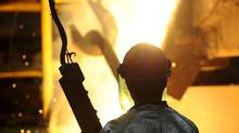A worker pours molten metal from a furnace into a ladle during casting at the Wabi Iron and Steel fabricating division and foundry in New Liskeard, Ont. (Fred Lum/Fred Lum/The Globe and Mail)