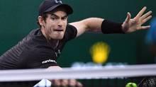Andy Murray hits a return against Roberto Bautista Agut in their men's singles finals match at the Shanghai Masters on Oct. 16, 2016. (Johannes Eisele/AFP/Getty Images)