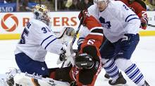 File photo: New Jersey Devils left winger Zach Parise (9) gets sandwiched between Toronto Maple Leafs goaltender Jean-Sebastien Giguere and defenceman Luke Schenn during third period NHL action in Toronto on Tuesday, February 2, 2010.THE CANADIAN PRESS/Frank Gunn (Frank Gunn)