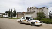 Members of the Royal Canadian Mounted Police patrol the streets in High River, Alberta, June 29, 2013. The RCMP came under fire this week for searching people's homes and confiscating their firearms. (TODD KOROL/REUTERS)