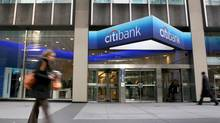 People walk past Citigroup headquarters in New York. (Craig Ruttle/AP)