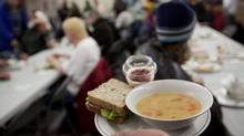 Lunch is served at the Surrey Urban Mission on Jan. 7, 2013. (Deborah Baic/The Globe and Mail)