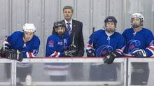 Prime Minister Stephen Harper coaches the Conservative hockey team during its game against the Liberals in Ottawa on April 15, 2008. (Bill Grimshaw)