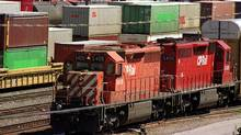 Freight trains in a rail yard in Calgary (JEFF MCINTOSH/JEFF MCINTOSH/CP)